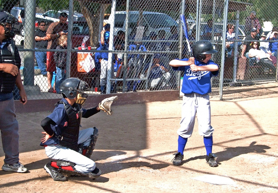 Piru held their opening ceremonies last Saturday. Above catcher Freddy Hurtado (Red Sox) and hitter Brendon Baker (Dodgers) show how it is done.