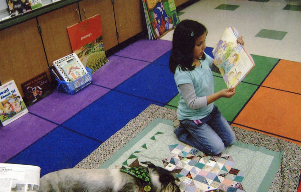 Anahi and Pepper the Reading Dog enjoy each other's company.