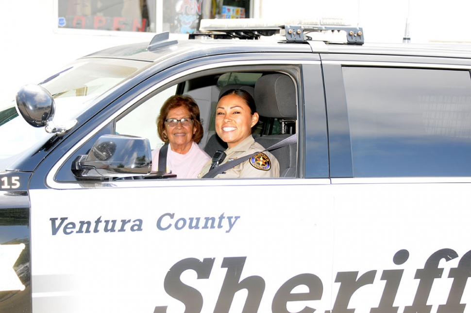 Monday, June 3rd at 11 a.m., just outside the Fillmore Police Station, Deputy Veronica Grayball was seen giving a ride along tour to Vicenta Hidalgo, as part of the Spanish Citizens Academy Program, where the students get a chance at a hands-on experience of police work.