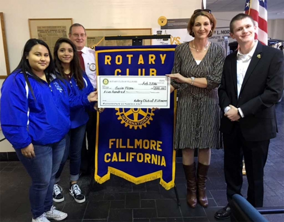 Rotary presents $500 donation to FHS Swim Team. The Rotary Club presented a check for $500 to the FHS swim team. Team members with Kyle Wilson, President and Swim Coach and Teacher, Telana Burns.