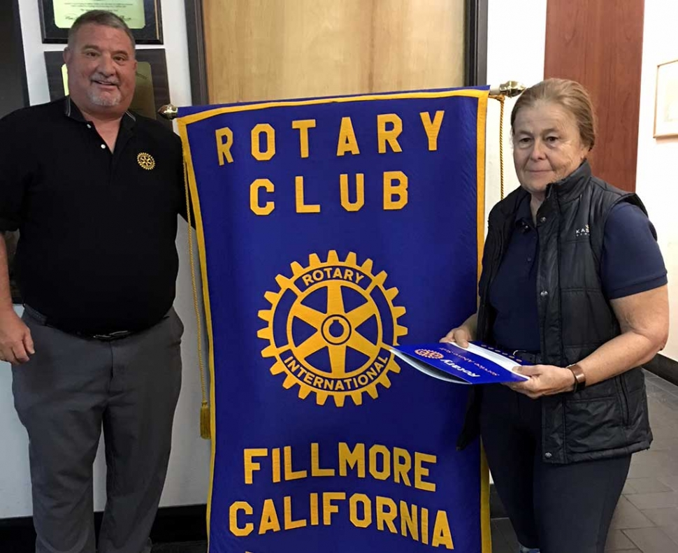 Fillmore Rotary Club President Dave Wareham initiated the newest Rotarian, Barbara Filkins. Photo Courtesy Martha Richardson.