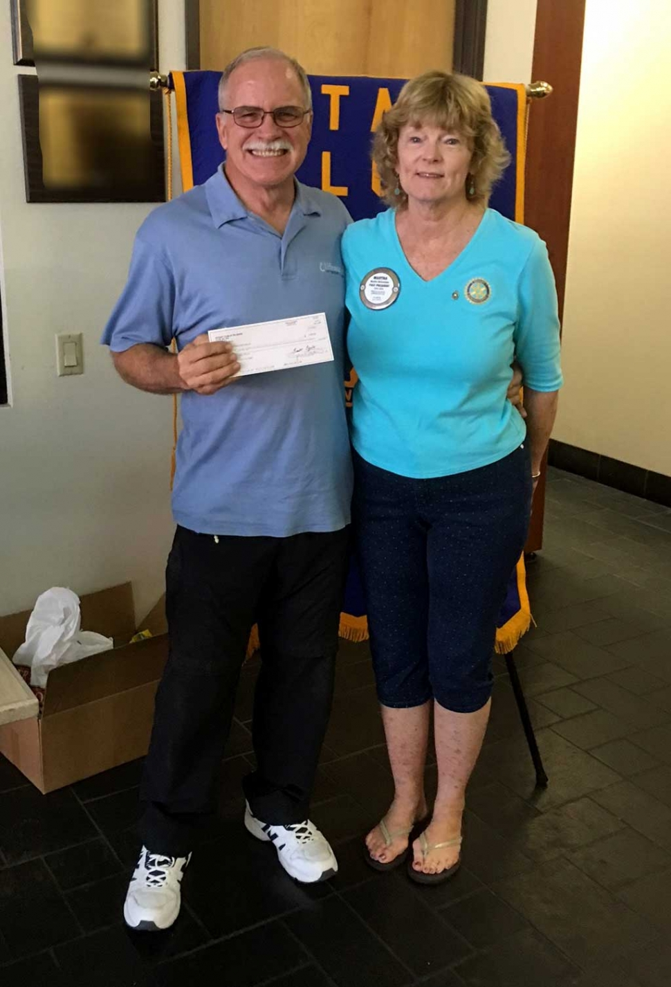 Rod Thompson of Life Water accepted a donation from Martha Richardson. Life Water is an International group that builds water wells in needy countries, teaches the people how to maintain the wells, sanitation, and how to have a healthy life.