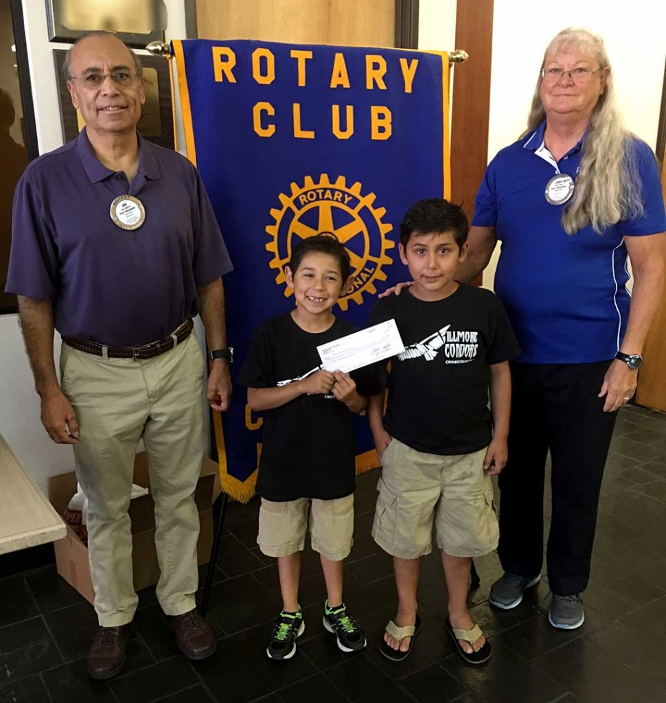 Rotarians Joe Aguirre and Cindy Blatt presented a donation check to Diego & Santiago Felix, members of Condor Youth Cross Country.