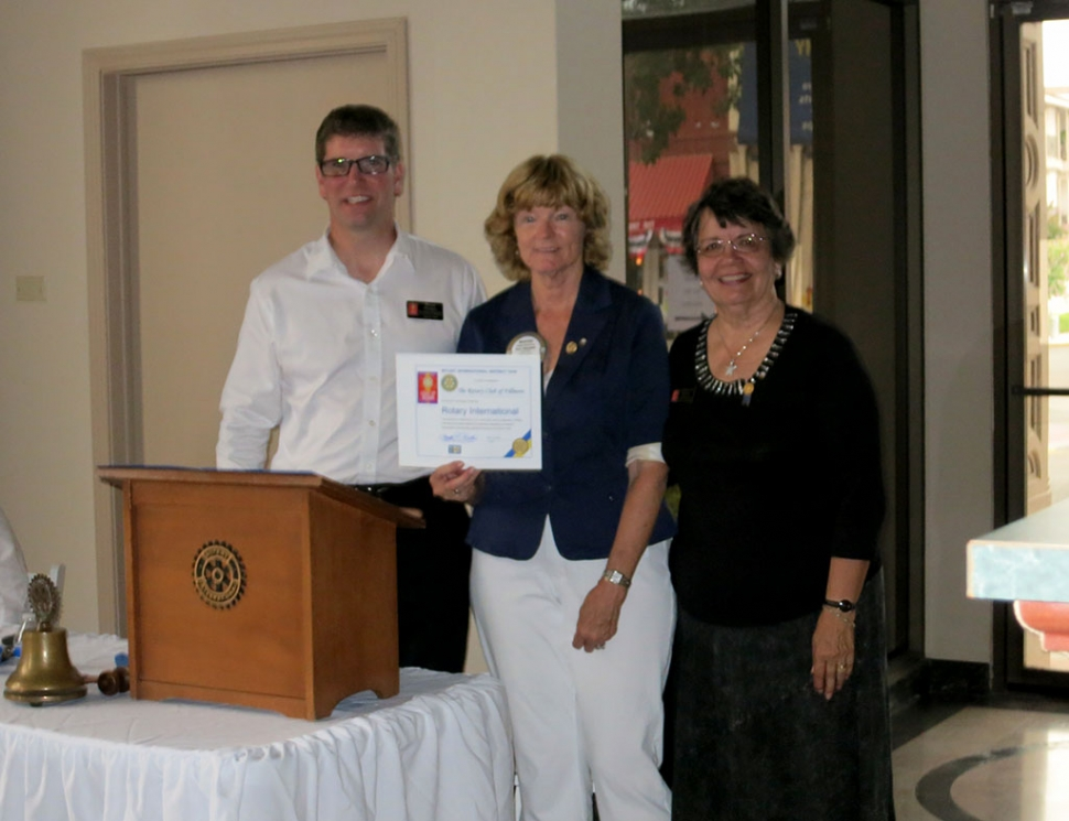Sean Morris, Rotary President and Martha Richardson, Secretary were presented with a certificate from Rotary International recognizing 90 years of service. It was presented by Loretta Butts, 2014-2015 District Governor.