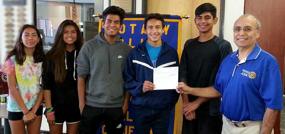 Members of the Fillmore High School Cross-Country Team were presented with a check for $150 by Joe Aguirre of the Fillmore Rotary Club for their win in the Heritage Valley 5K Team Challenge. Pictured (l-r) are Diana Perez (11th), Vanessa Avila (10th), Sergio Perez (11th), Everardo Garcia Magana (12th), and Nick Villela (11th), Joe Aguirre. Photo Courtesy Cindy Blatt.