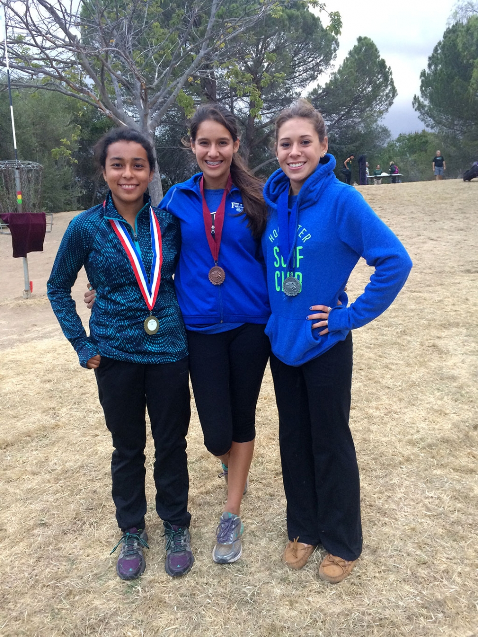 The Lady Flashes Medalist at the Ventura County Cross Country Championships. (l-r) Jackie Chavez, Alexis Tafoya and Jordan Manzano