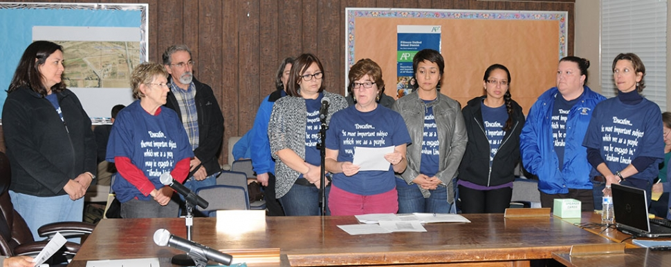 Teacher Sandy Butts, center, and fellow teachers addressed concerns at Tuesday night's school board meeting.