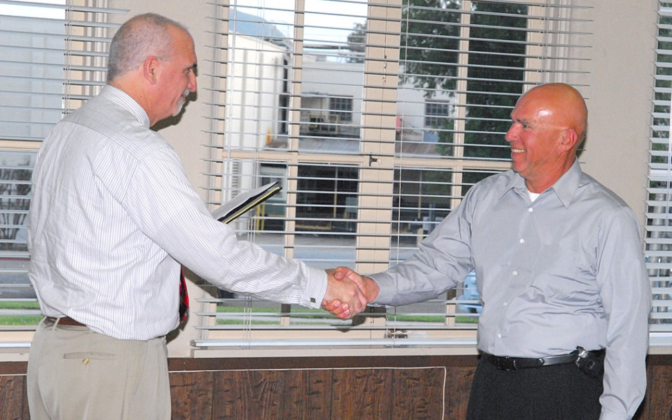 FUSD Superintendent Sweeney welcomes new school board member Michael Saviers at Tuesday night's meeting.