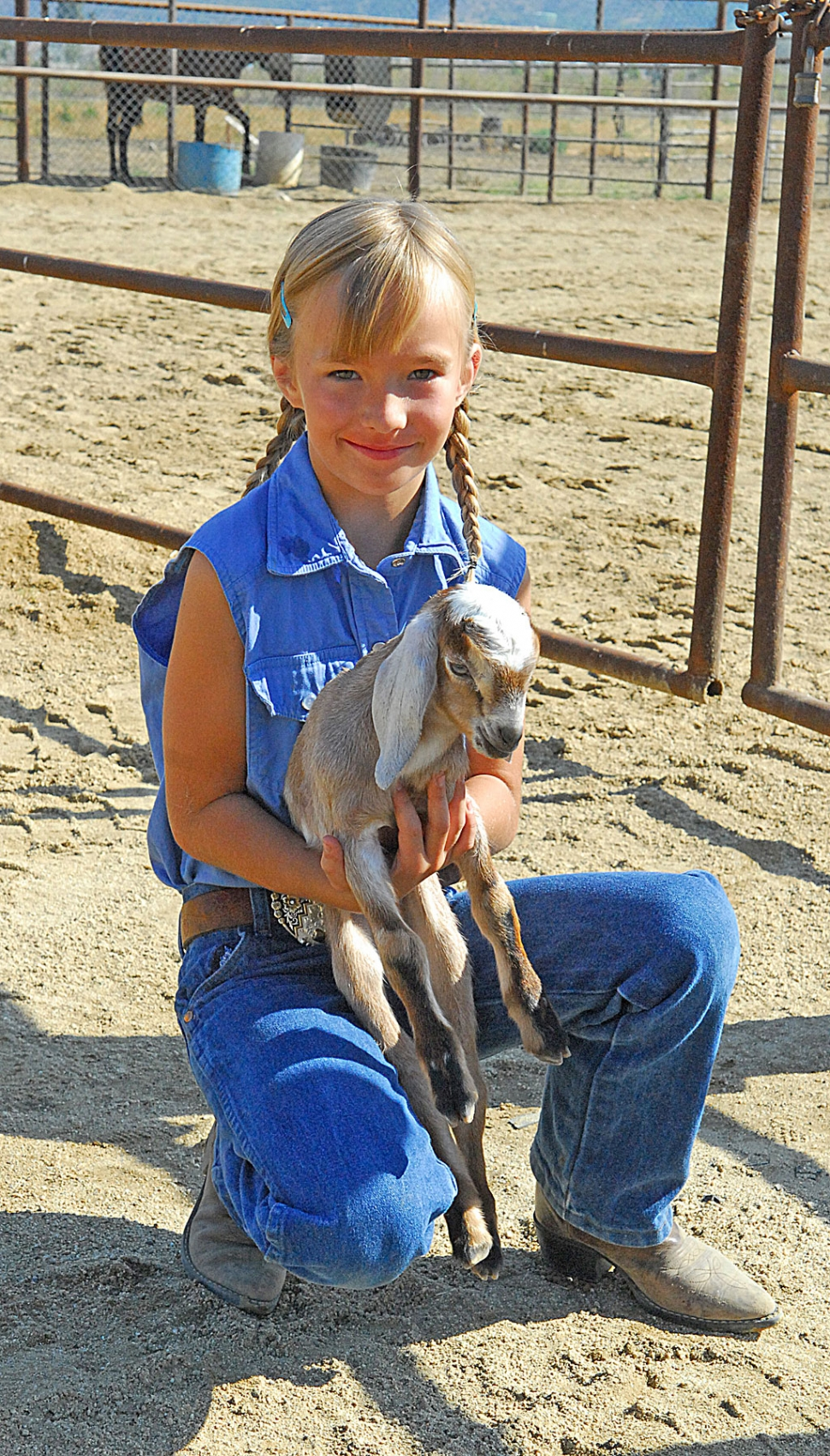 Practice showmanship took place Saturday at the school Farm. Pictured here is a young lady holding a newborn goat. The Gazette would appreciate it if all visitors and participants at the Farm would identify their photos for all to enjoy. A story on the pre-Ventura County Fair entrants will be posted Monday.