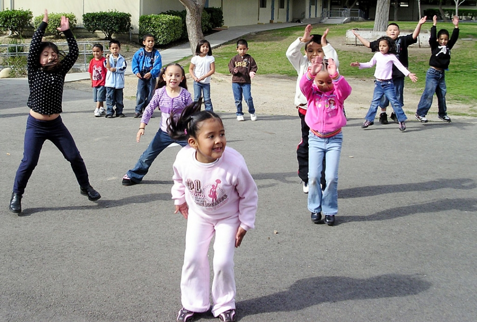 Marlene Garcia, Jasmine Vasquez, Xochitl Ruiz, Yulizza Aguilar and Jovanny Figueroa lead the Kindergarteners in jumping jacks.