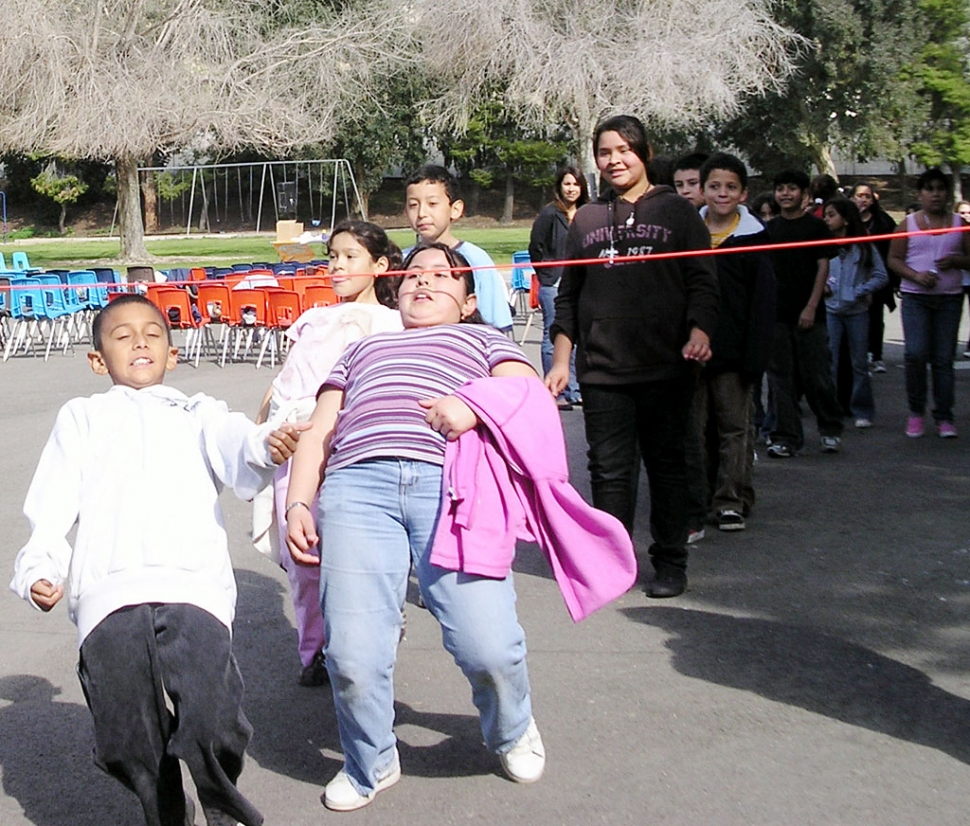 Fifth grade students wait in line to see how low they can go.