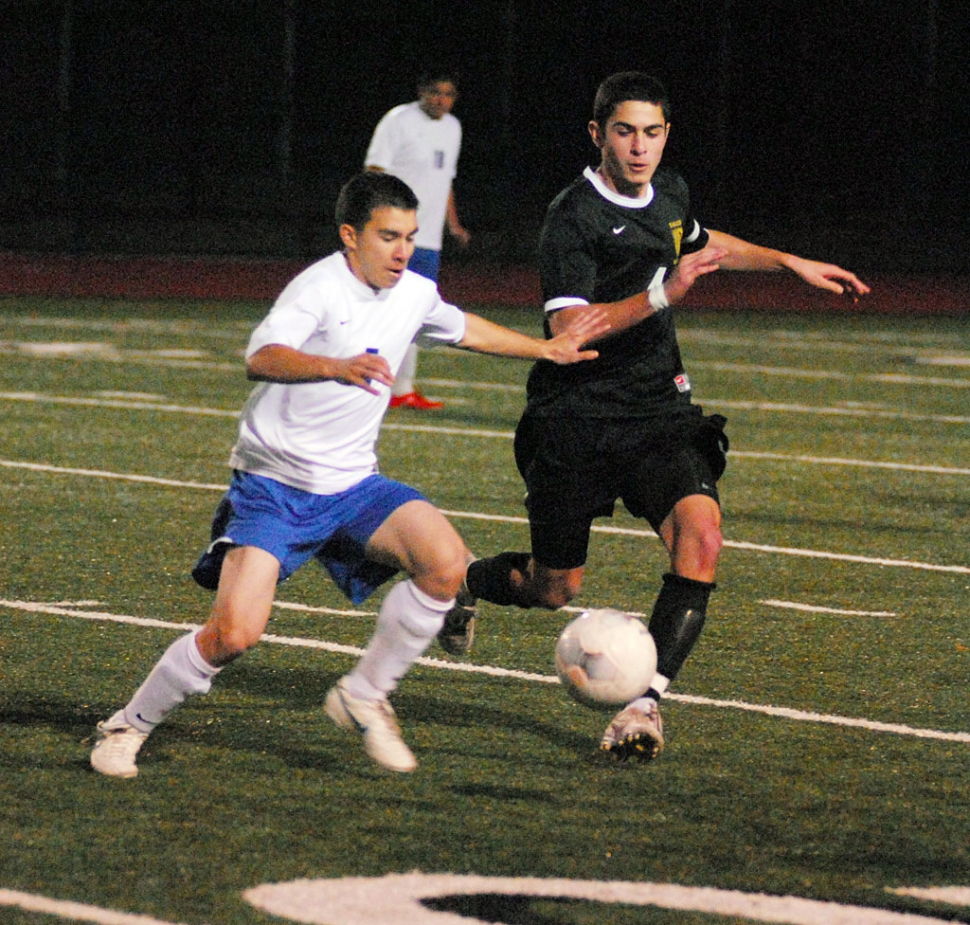Gerardo Calderon controls the ball and keeps it from Oak Park.