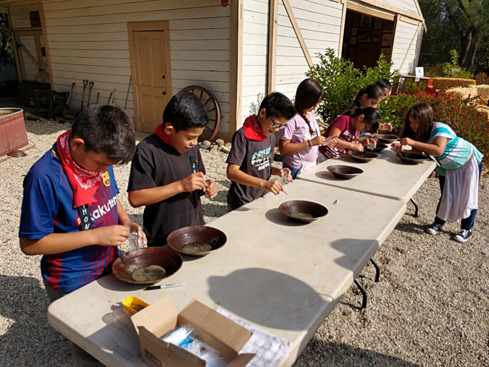 Students learning how to pan for gold just like the pioneers use too.