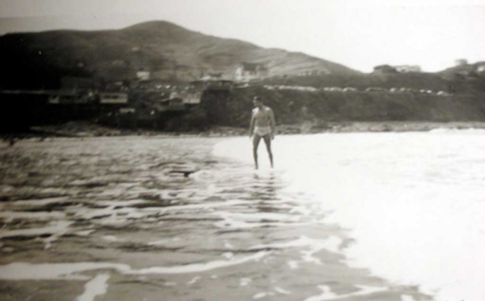 Uncle Dick Keating surfing Pacifica, CA in the early 1940's. Photo credit: Dick Keating