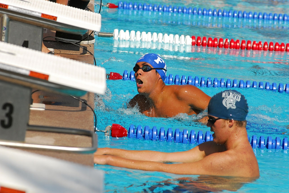 Andres Casas finishes the race against Villanova during last Wednesday's swim meet.
