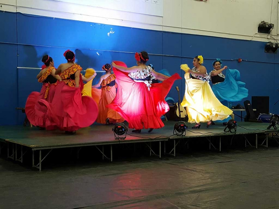 The FHS Talent Show was held on Friday, April 28th to a packed house. The dance acts were very diverse and equally marvelous. They ranged from Ballet Folklorico (above) to K Pop to Latin back up dancers, singing, magic, drama and literary readings. Ms. Benavidez sang Gloria Estefan's Mi Tierra, with girls from Ballet Folklorico performing as back up dancers. Contemporary songs where sung but also surprisingly songs for the older set were performed. Frank Sinatra's New New, York New York and Elvis' Can't Help Falling in Love. Also a wonderful song from A Chorus Line was performed. The musical acts were very good and bordered on folk and soft rock. A dramatic reading and a magic trick were two acts performed by Mr. Murphy. A very humorous dramatic scene peppered with crazy dance interludes kept the crowd laughing. The Improve Club took suggestions from the audience and adlibbed two different scenes. They were very ingenious and yet funny.