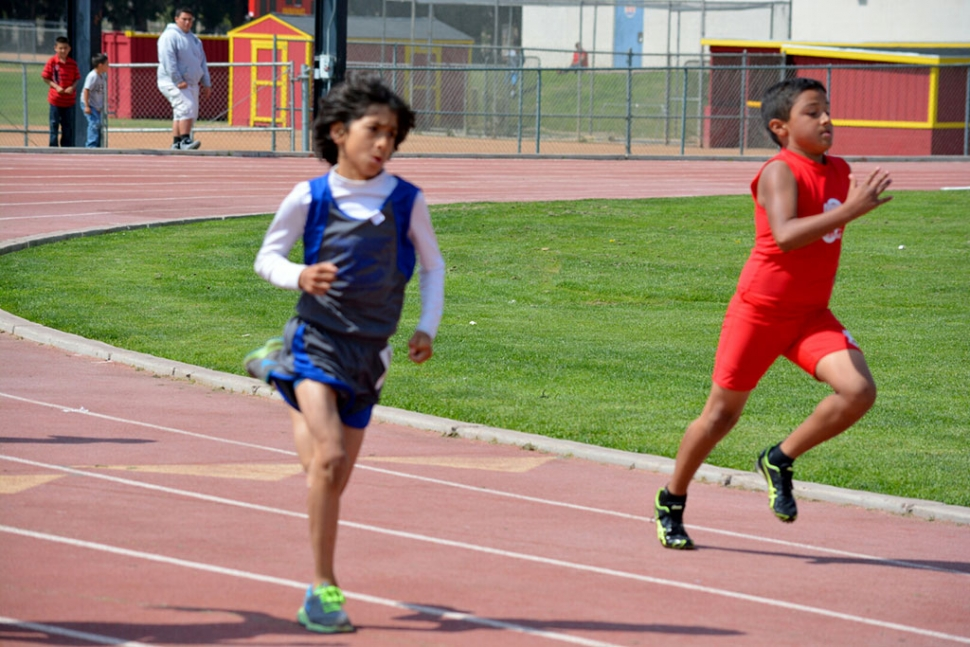 (left) Isaac Ortiz who placed 1st in the 800m dash Midget division.