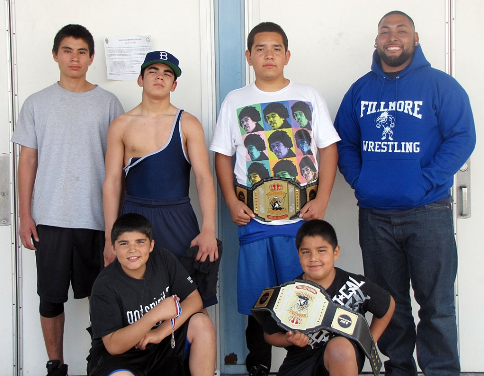 On March 28th 5 wrestlers from Fillmore competed in the Warriors Challenge in Norwalk. Pictured above (l-r) Alex Rivera competed in the 16 year old bracket at 135 pounds, Robert Bonilla wrestled as a 15 year old at 125 pound, Rafael Hernandez wrestled as a 14 year old at 192 pounds, taking first place, Coach David Navarrete. Bottom row (l-r) Andrew Bonilla wrestled as a 13 years old at 125 pounds took 2nd place and Adrian Bonilla wrestled as an 8 year old and first place in the 105 pounds bracket. If you are interested in joining the team please call 805-794-5951, and speak with Jorge Bonilla.