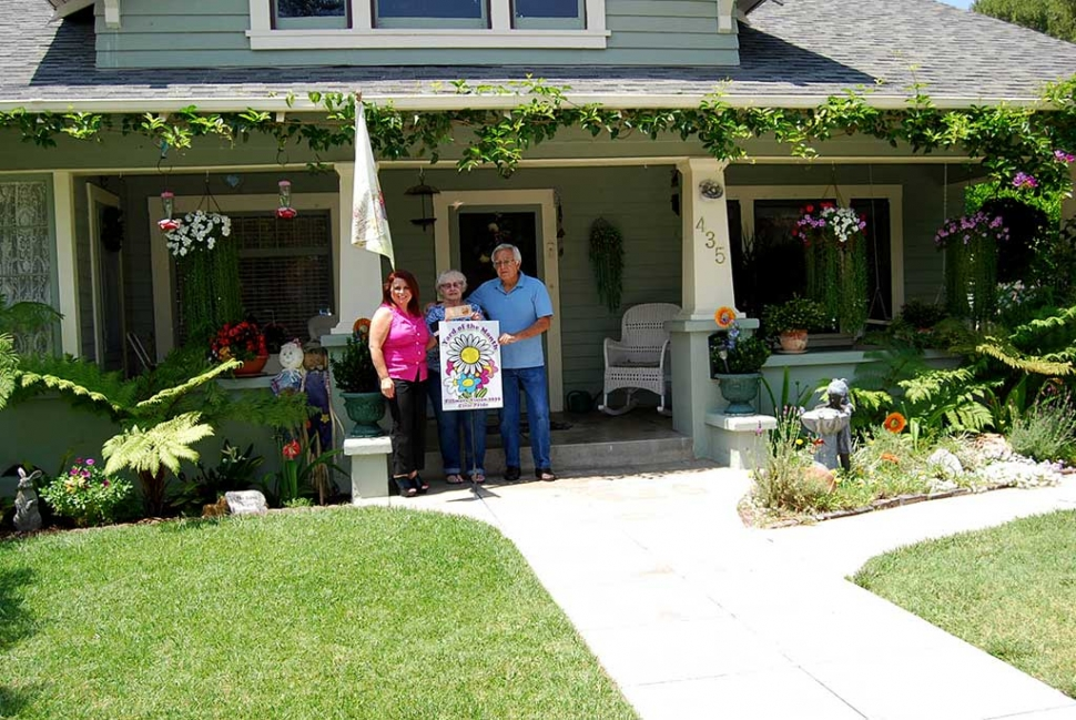 Theresa Robledo with Civic Pride Vision 2020 presents Yard of the Month to Adrian & Carol Rivera. Congratulations! This Craftsman Style Home located on 435 Fillmore Street is beautifully gardened with Geraniums, Begonias, mix of Gerber Daisies, Lavender, Amarillo flower, Flowering Christmas Cactus, Lavender Trumpet Vines, Hanging Impatience and Wisteria Vines which makes this home so inviting to sit on the front porch and enjoy chirping birds invade the garden looking for juicy grubs and shiny seeds. Thank you to Otto & Sons Nursery for the generous gift certificate to the Rivera Family.