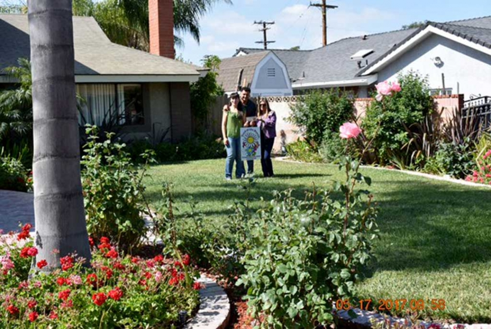 (l-r) Norma Gil, Jose Gil, and Ari Larson. The May 2017 Yard of the Month was presented to Jose and Norma Gil along with a $40 gift certificate (courtesy of Otto & Sons) by Ari Larson (representing Fillmore Civic Pride). Some of the pleasing landscape features include, roses, Arum Lily, Lantana, ferns, palms garden sage, geraniums and formio. The home is located at 254 Casner Way. For more information on Fillmore Civic Pride please call Ari at 805-794-7590.
