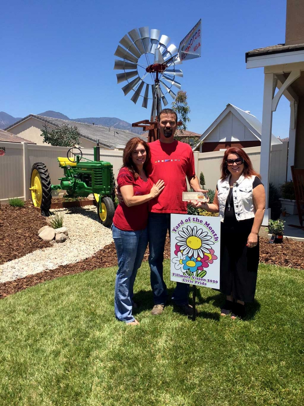 Yard of the Month winners Kevin and Sheryl with Theresa Robledo.